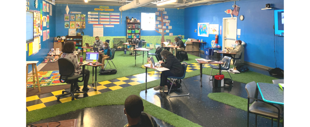 Interior of classroom painted blue with AstroTurf floors.