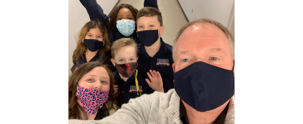 Selfie image of Dr. Gott and 5 elementary students while wearing masks.
